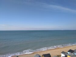 The view of the bright blue ocean and the sky along a Dorset beach