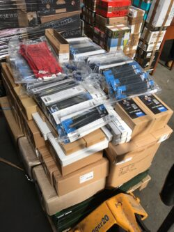 Boxes of tool supplies kindly donated from Draper Tools stacked up on a pallet truck